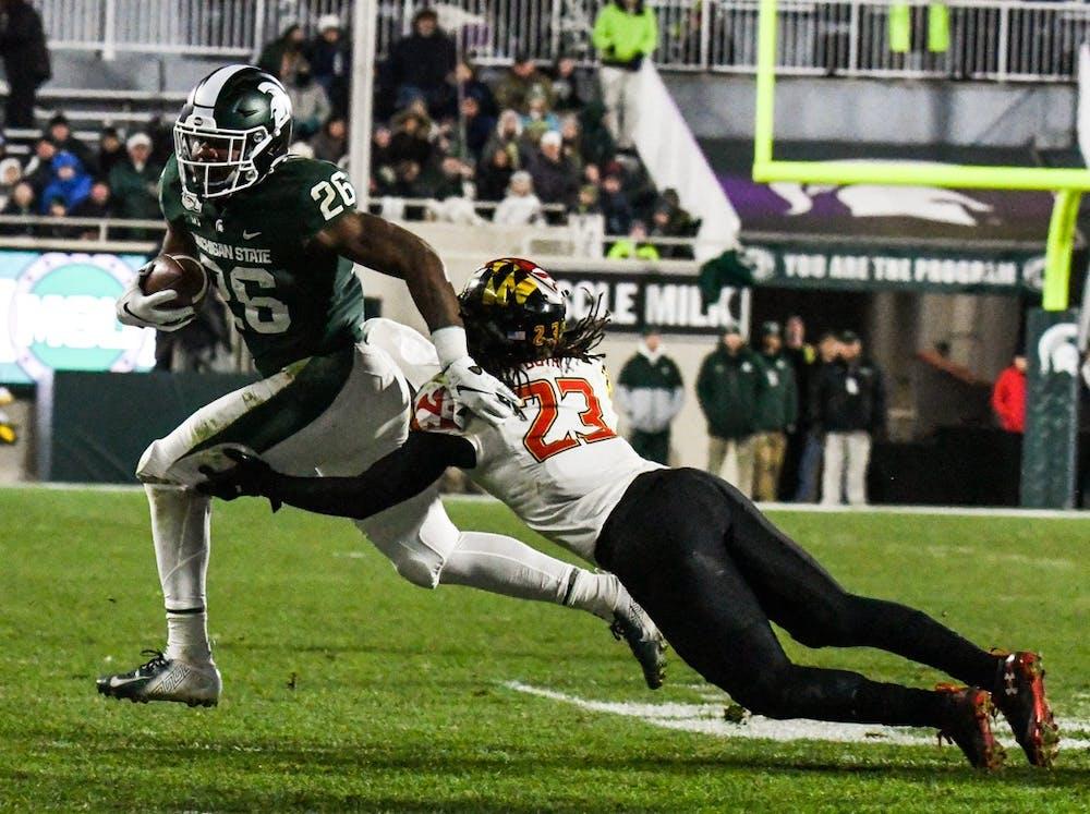 <p>Maryland linebacker Fa'Najae Gotay tackles freshman running back Brandon Wright (26) during the game Nov. 30, 2019, at Spartan Stadium. The Spartans beat the Terrapins 19-16.</p>