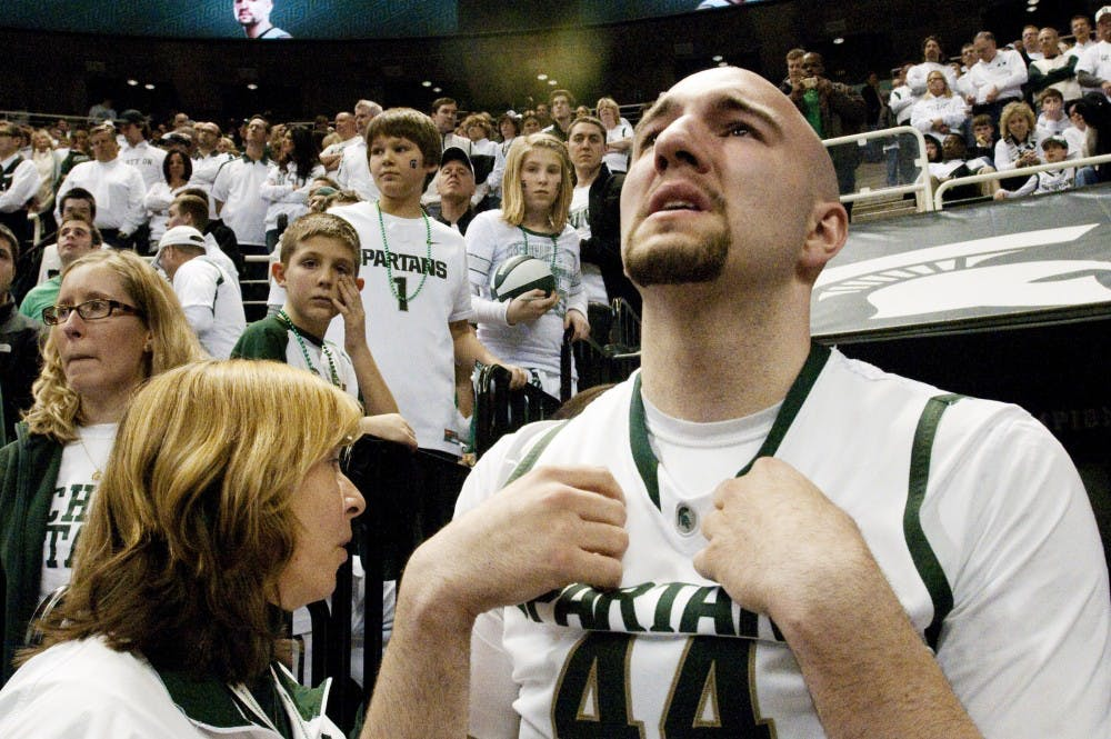 Senior center Anthony Ianni looks up to the big screen with tears in his eyes on March 24, 2012 at Breslin Center. The preceding 72-70 loss to Ohio State was the last game Ianni will play at Breslin Center. State News File Photo`