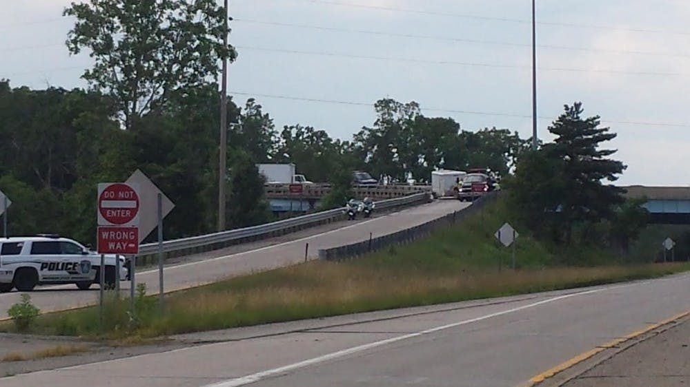 <p>Workers make efforts to reopenthe northbound US 127 exit to Trowbridge Road onJune 29, 2015, after an accident involving a semi-truck closed the off-ramp.</p>