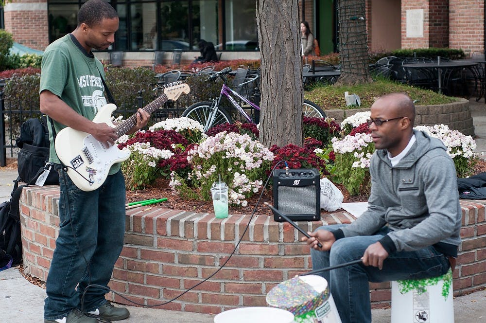 "<p>East Lansing residents Ricard Taylor, right, and Taro Taylor, left, photographed on Oct. 30, 2013, were street performers on Grand River Avenue before Ricard Taylor was charged in the shooting deaths of two people Wednesday. The brothers had previously been featured <a href=""http://statenews.com/article/2013/11/living-city-playing-in-unison"">in a Living City</a>.</p>"