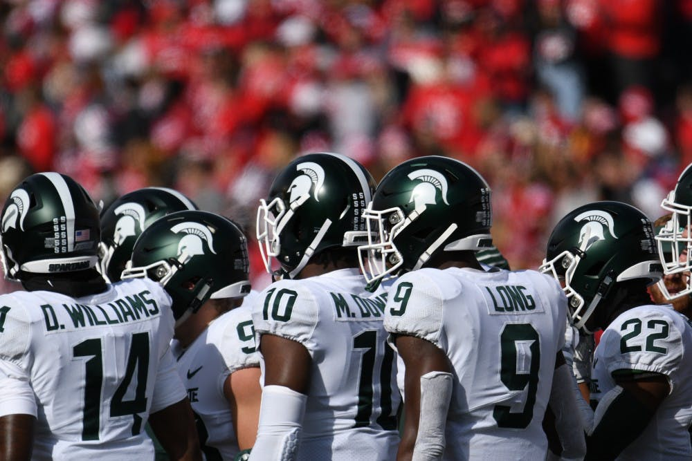 MSU football players during the game against Wisconsin at Camp Randall Stadium on October 12, 2019. The Spartans lost to the Badgers 38-0.