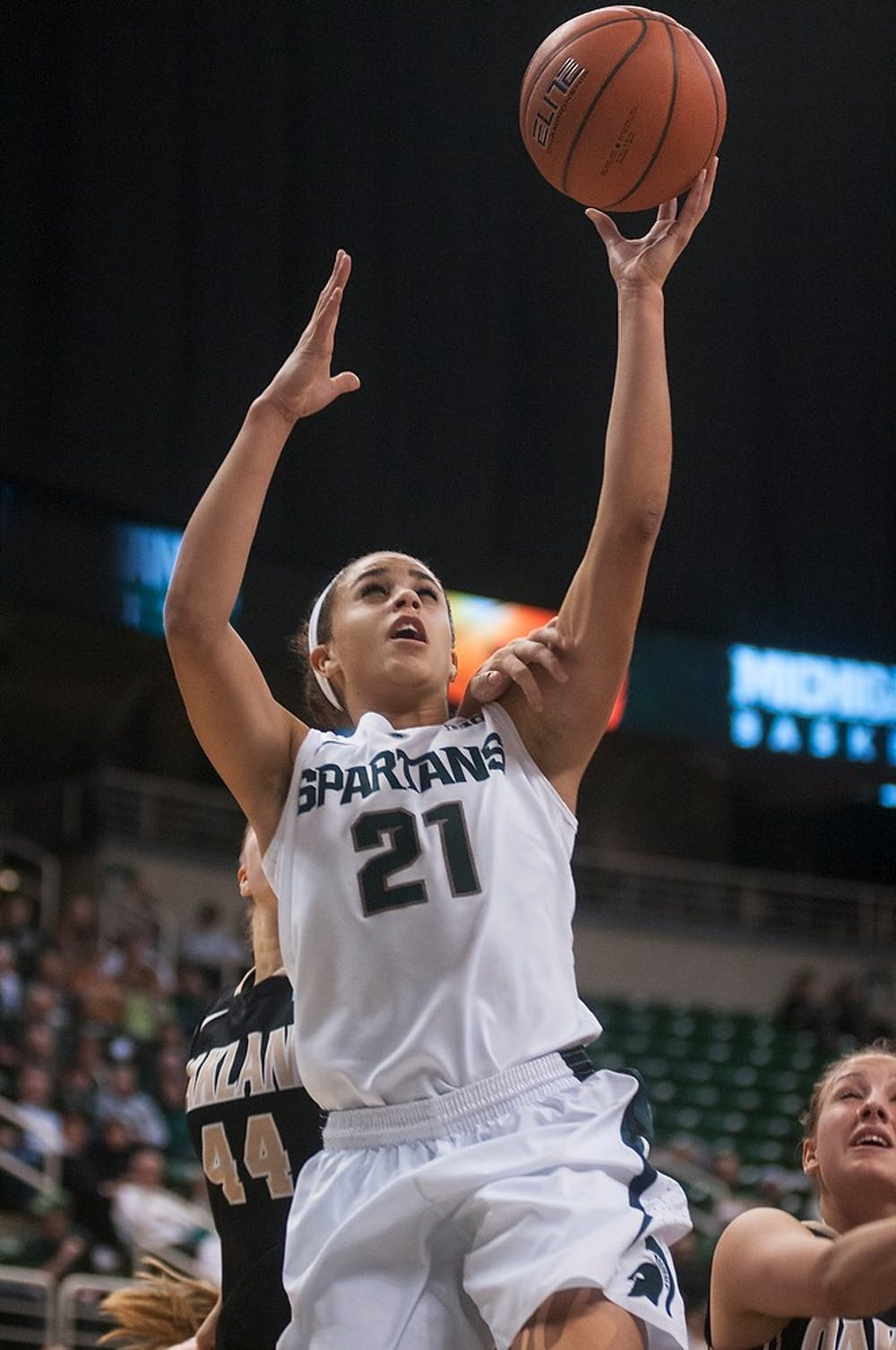<p>Senior guard Klarissa Bell goes up for a shot during the game against Oakland on Dec. 15, 2013, at Breslin Center. The Spartans defeated the Grizzlies, 80-62. Danyelle Morrow/The State News</p>