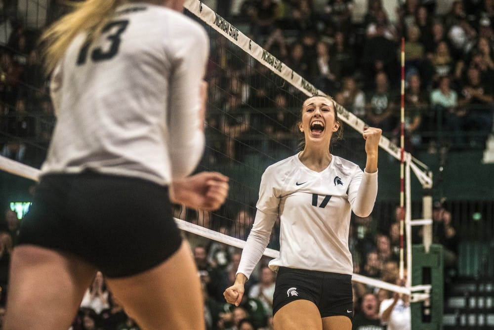 Senior middle blocker Alysaa Graveling (17) reacts to a play during the game against Ohio State on Sept. 30, 2017 at Jenison Fieldhouse. The Spartans defeated the Buckeyes, 2-0.
