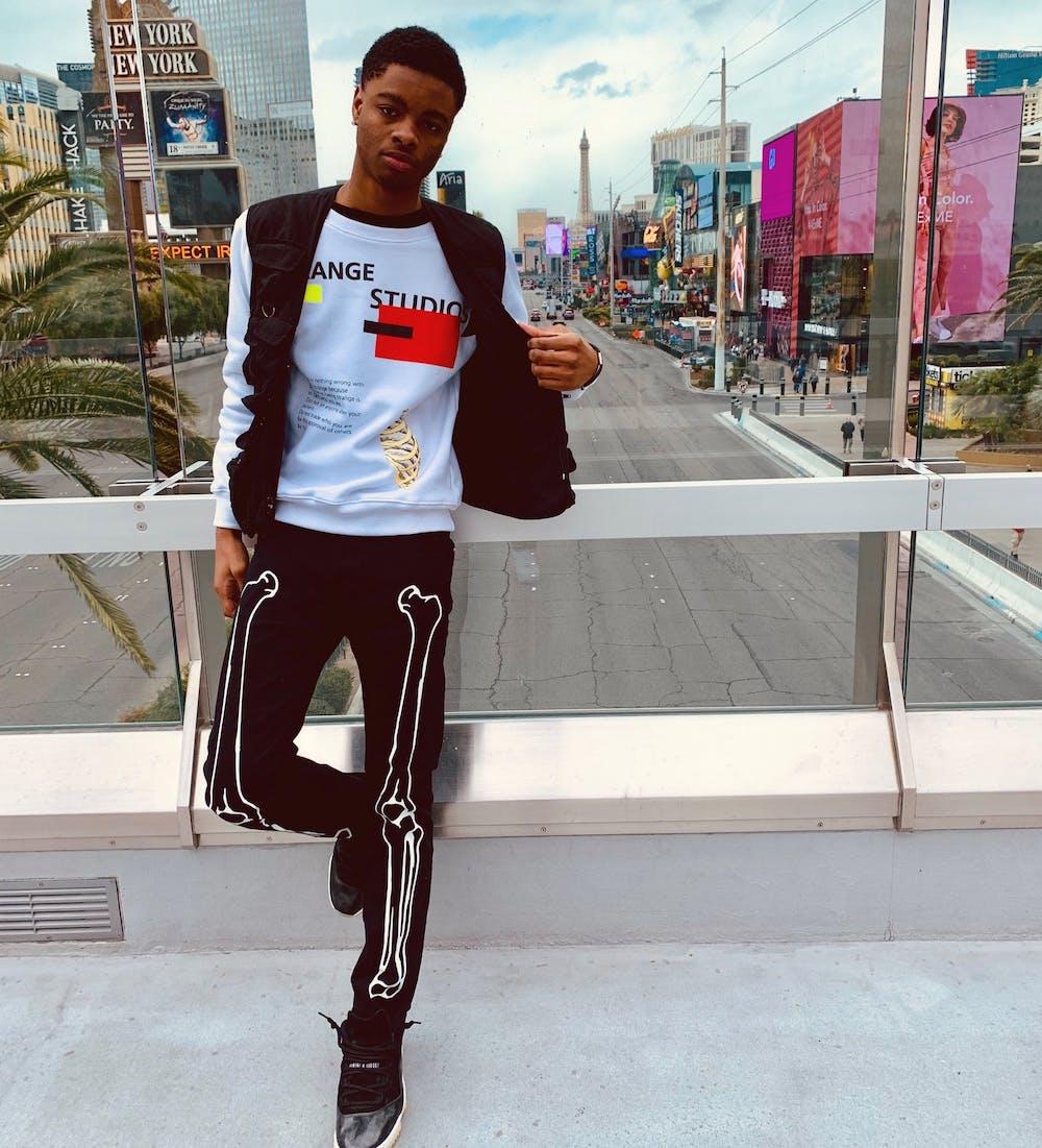 <p>MSU apparel and textile design student Shelton Hawkins Jr., 19, modeling an outfit from his brand, &quot;Étrange Studios.&quot; Photo courtesy of Shelton Hawkins Jr.</p>