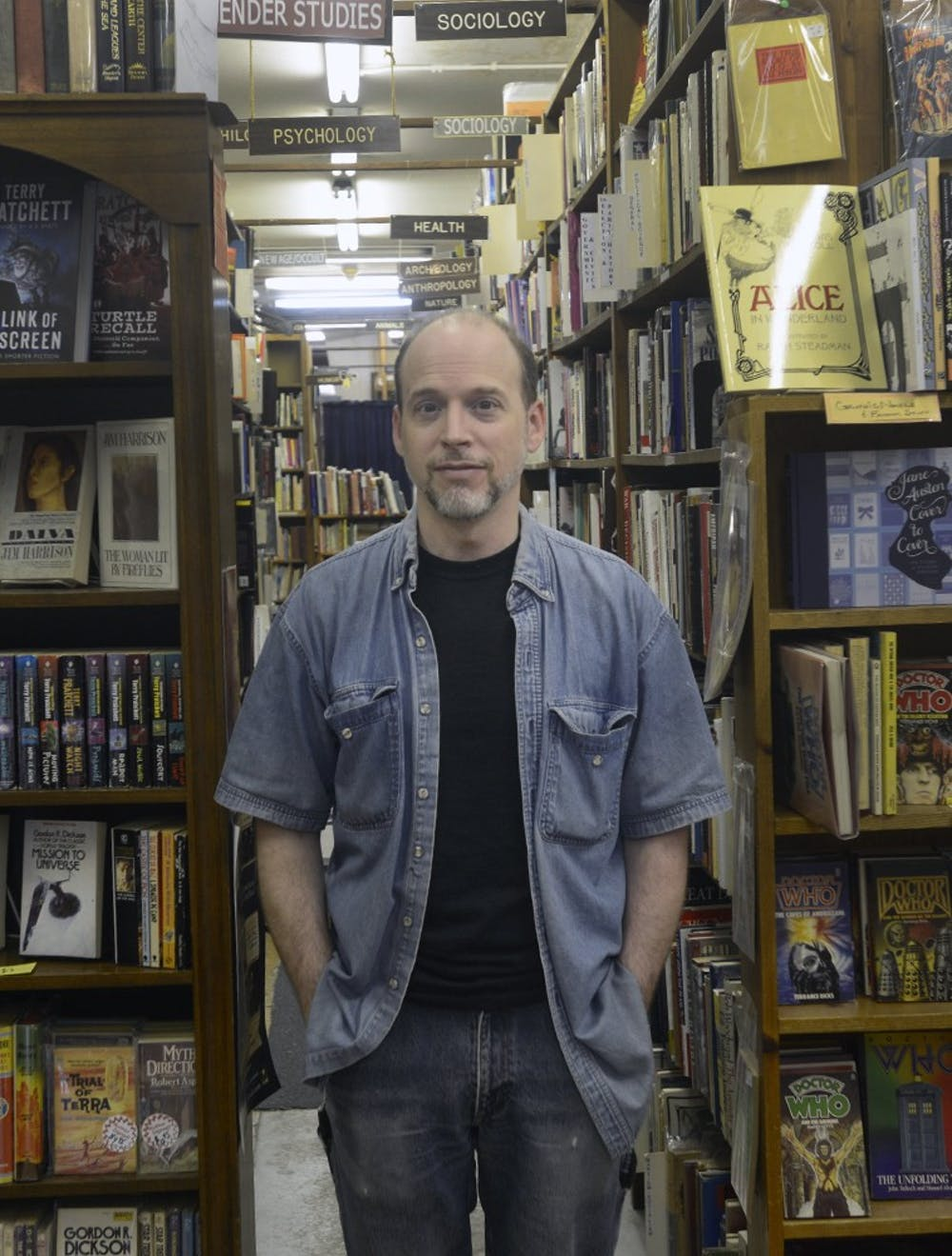 <p>Member of Curious Books for nearly ten years and now manager, Mark Wojcik, says he's always wanted to work in a smaller, more personal book shop and took the opportunity as soon as he got it June 5th, 2015 at Curious Books. Wyatt Giangrande/State News</p>