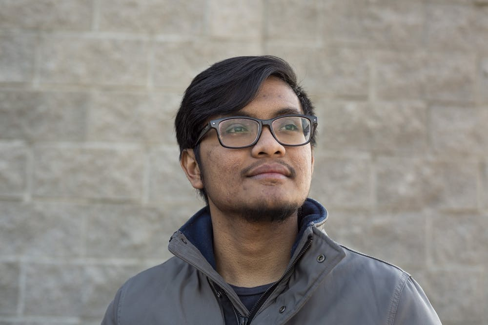 <p>Mathematics senior Zafri Abd Halim poses for a portrait on Nov. 24, 2019 at Al Saad Market in Detroit, Michigan. </p>