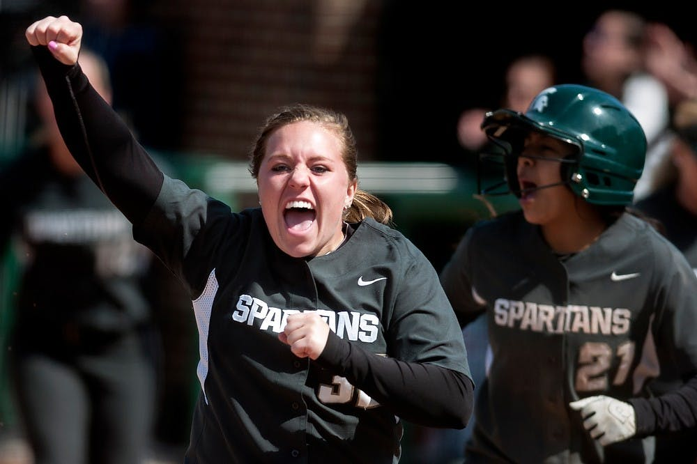 "<p>Junior catcher Emma Fernandez, left, celebrates as she runs towards the home plate after junior outfielder Sarah Bowling hit a home run in the bottom of the fourth inning, Saturday, March 30, 2013, at Secchia Stadium at Old College Field. <span class=""caps"">MSU</span> defeated Indiana in the second game of the three-game series by 10-7. Justin Wan/The State News</p>"