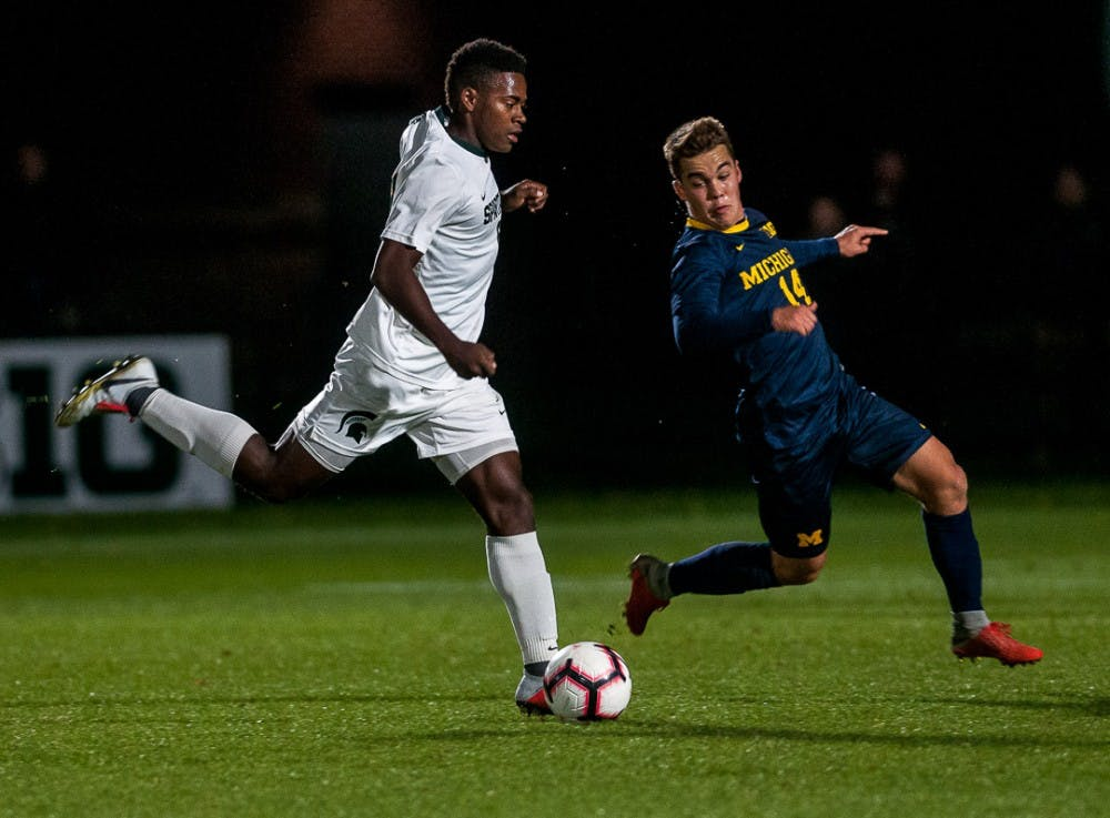 <p>Senior forward Dejuan Jones (6) looks for a pass during the game against Michigan on Oct. 23, 2018 at DeMartin Stadium. The game ended in a 1-1 tie between the Spartans and Wolverines with double overtime.</p>