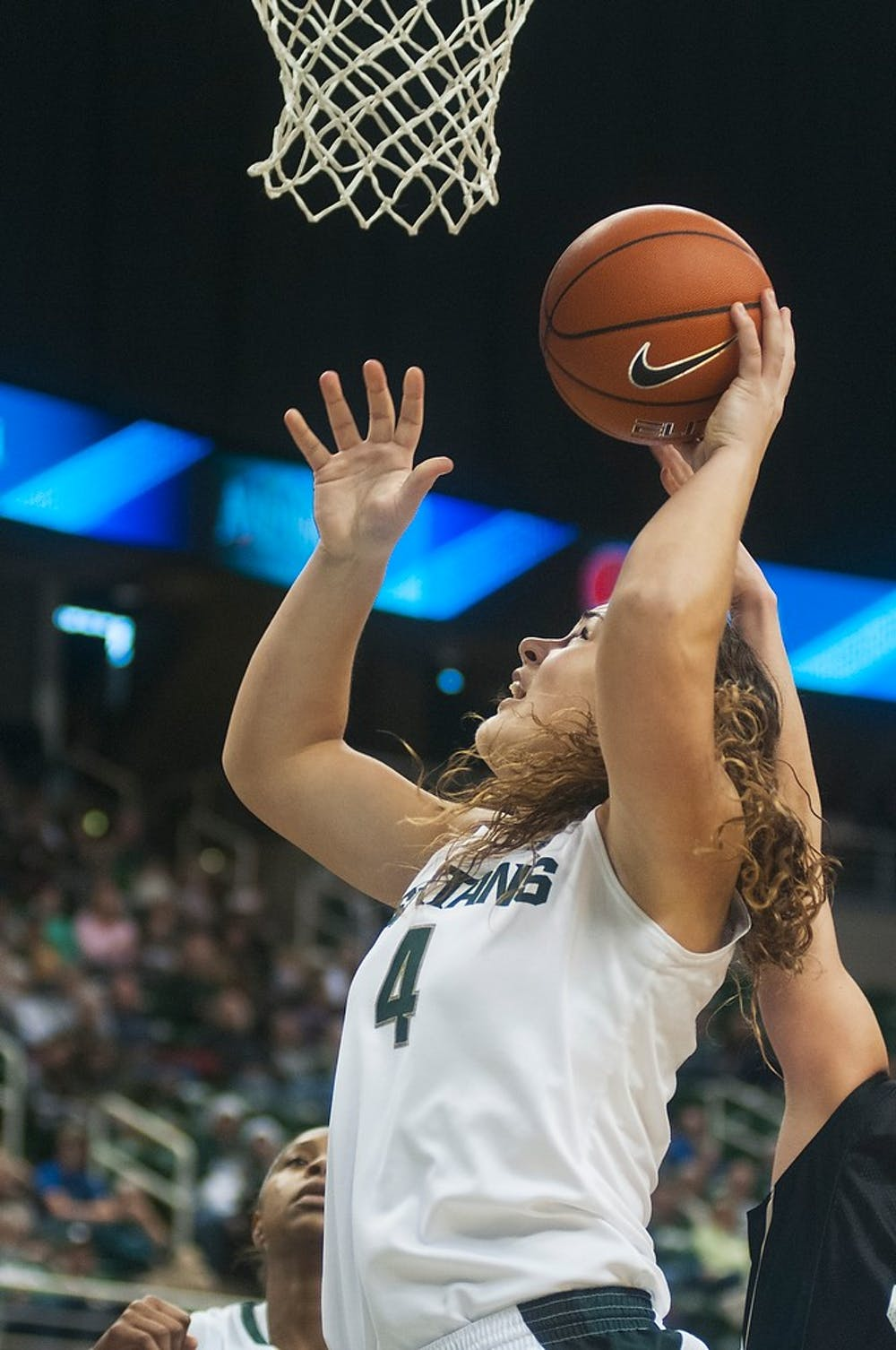 <p>Junior center Jasmine Hines goes up with a rebound during the game against Oakland on Dec. 15, 2013, at Breslin Center. The Spartans defeated the Grizzlies, 80-62. Danyelle Morrow/The State News</p>