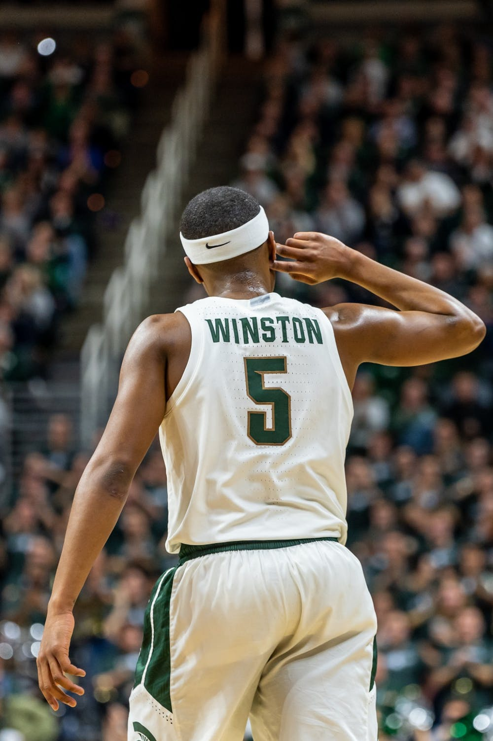 <p>Senior guard Cassius Winston gestures to a roaring crowd after hitting a three-pointer. The Spartans defeated the Hawkeyes, 78-70, on Feb. 25, 2020, at the Breslin Student Events Center. </p>