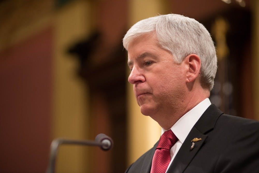 <p>Michigan Gov. Rick Snyder addresses the audience on Jan. 19, 2016 during the State of the State Address at the Capitol in Lansing, Michigan.</p>