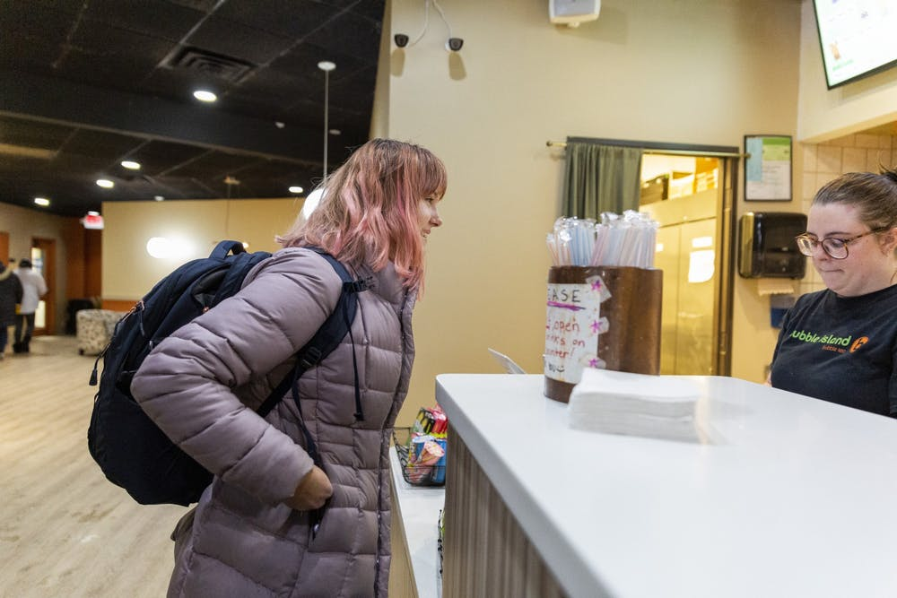 <p>East Lansing High School sophomore Katherine Hawthorne pays for her last bubble tea on Nov. 14, 2019. The East Lansing Bubble Tea Island location is set to close on Nov. 16. </p>