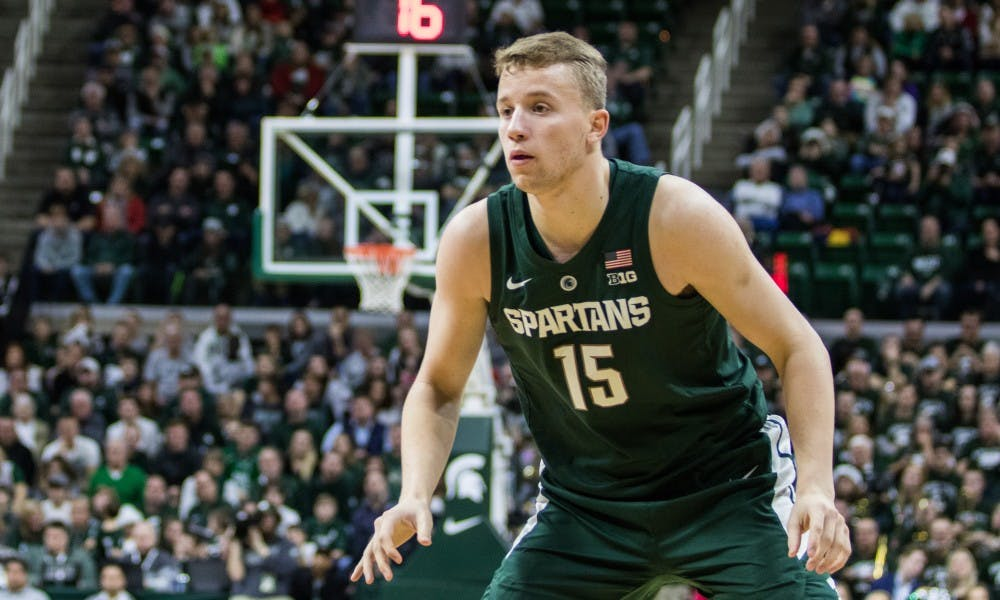 Freshman forward Thomas Kithier (15) waits for a pass during the game against Oakland University at Breslin Center on Dec. 21, 2018. The Spartans defeated the Grizzlies, 99-69.