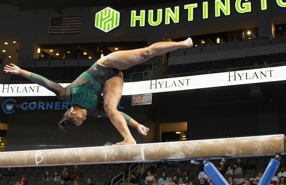 <p>Sophomore Alaina Raybon finishes her flip on Feb. 22, 2020 during Elevate the Stage at the Huntington Center in Toledo, Ohio. </p>