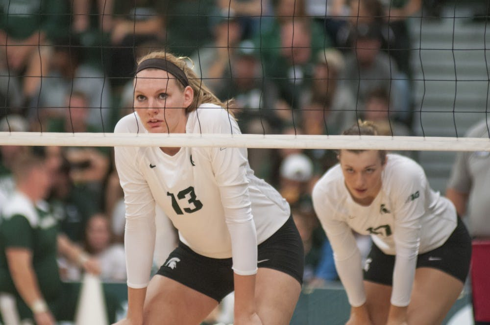 From left, redshirt  junior outside hitter Brooke Kranda (13) and junior mobile blocker Alyssa Grvelink (17) wait for a serve during the game against Nebraska on Sept. 24, 2016 at Jenison Field House. The Spartans were defeated by the Corn Huskers 3-2.