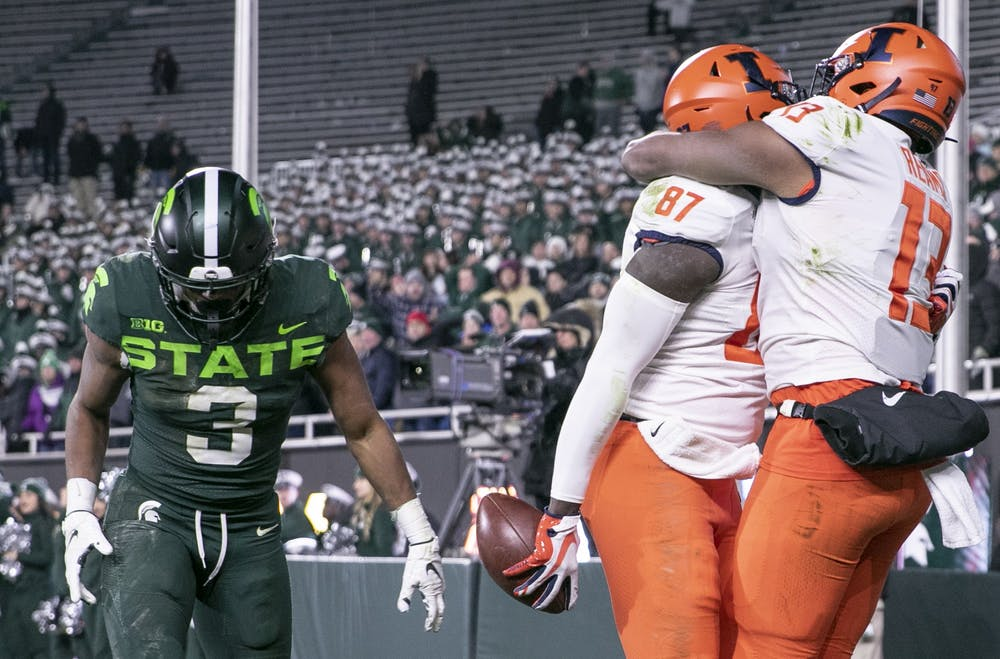 Illinois celebrates the game-winning touchdown catch during the game against Illinois Nov. 9, 2019 at Spartan Stadium. The Spartans fell to the Fighting Illini, 37-34.