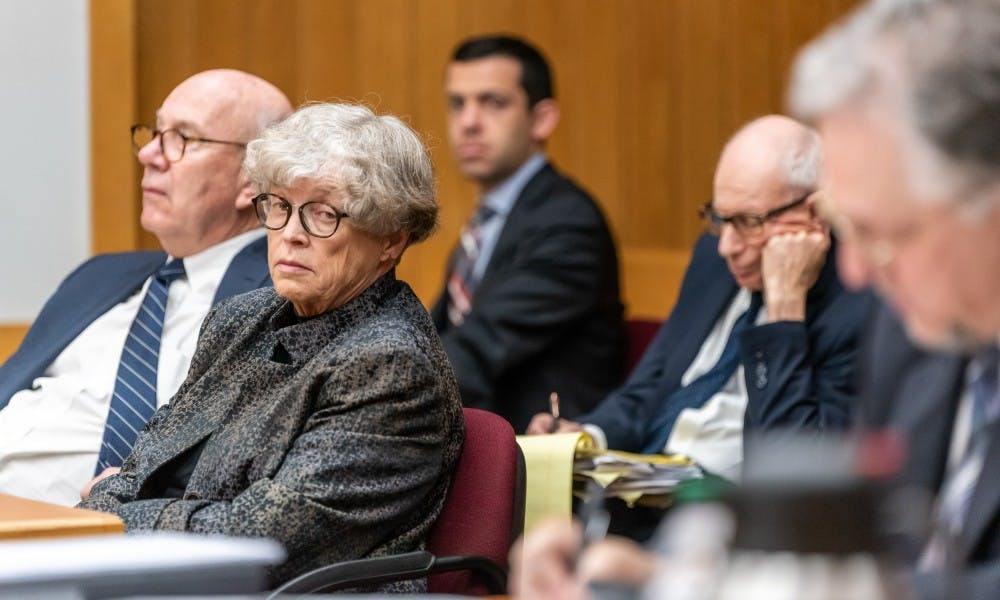 <p>Former MSU President Lou Anna K. Simon (second from left) looks over at Assistant Attorney General Scott Teter during her preliminary trial at the Eaton County courthouse on June 11, 2019. </p>