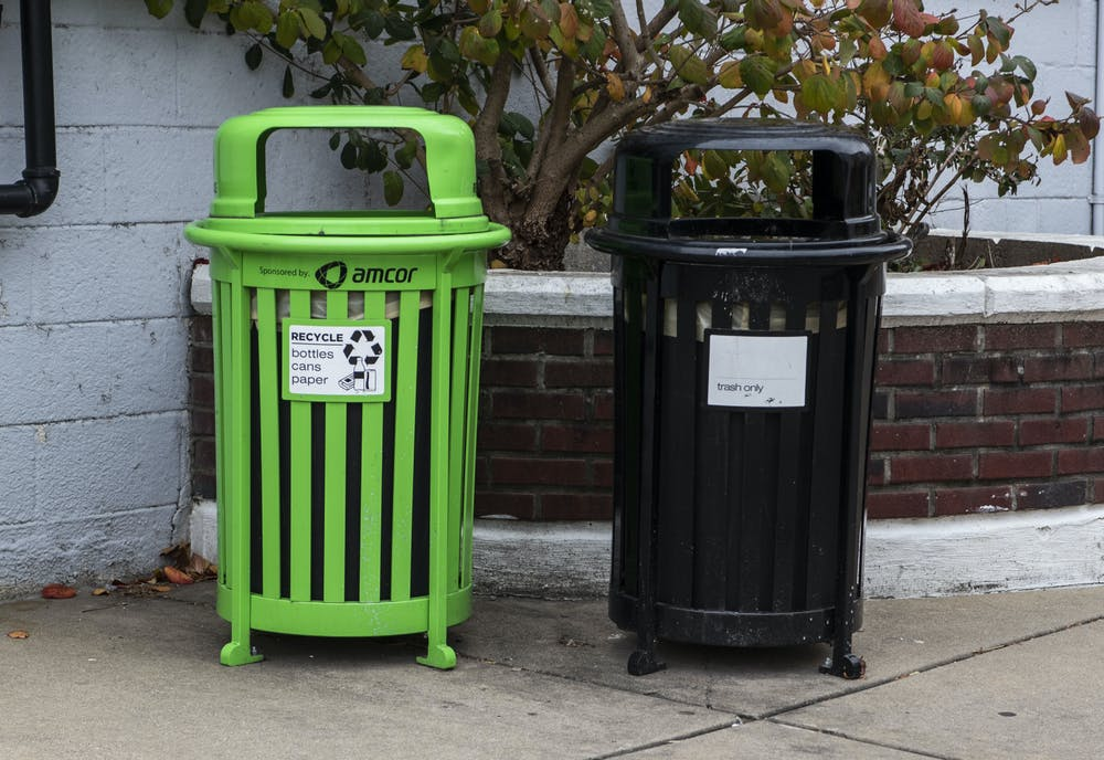 Recycling and trash bins located outside of Rice Kitchen behind Grand River Avenue. Shot on Dec. 1, 2020.
