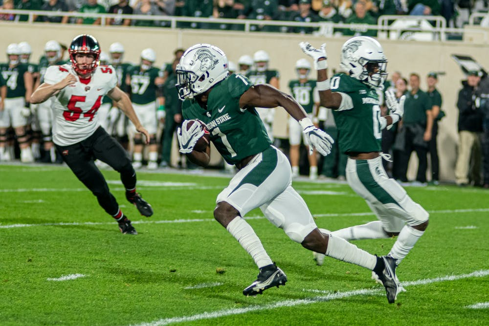 <p>Redshirt junior wide receiver Jayden Reed runs a punt return back for a touchdown on the first time the Spartans touched the ball. The Spartans dominated Western Kentucky in their homecoming game on Oct. 2, 2021</p>