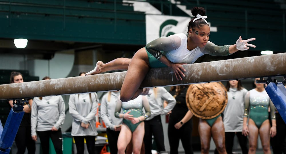 <p>Freshman Nyah Smith during her balance beam event at the gymnastics meet at Jenison Field House on February 16, 2020. The Spartans took the win over the Fighting Illini. </p>
