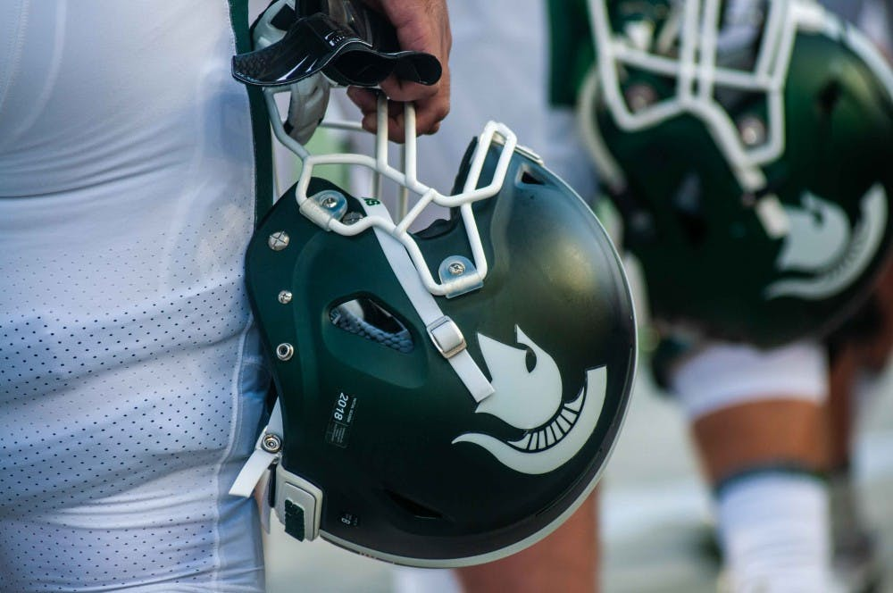 <p>A Spartan's helmet during the game against Utah State on Aug. 31 at Spartan Stadium. At halftime the Spartans were leading 20-14.</p>