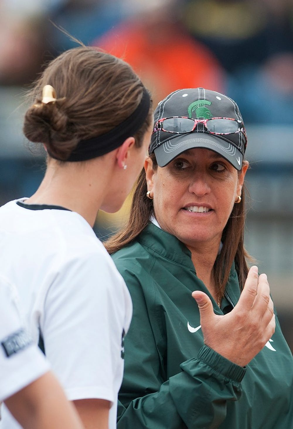 <p>Head coach Jacquie Joseph talks with junior catcher/outfielder Ellie Stoffer near the dugout during the game against Michigan on April 13, 2014, at Secchia Stadium at Old College Field. The Spartans were shut out by the Wolverines, 14-0. Danyelle Morrow/The State News</p>