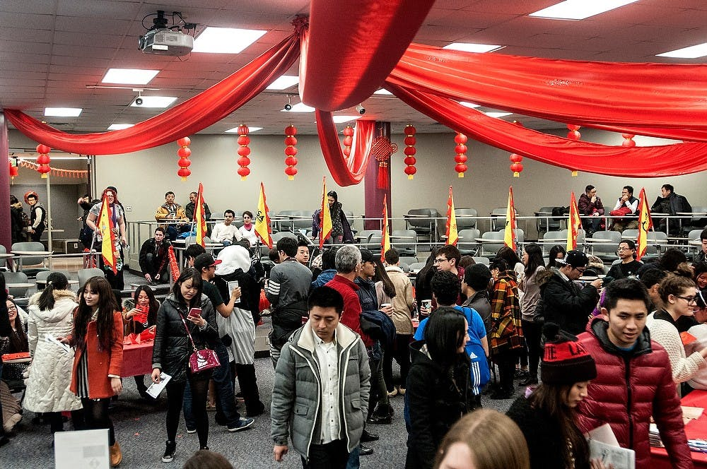 <p>Many people venture into the exhibit room Feb. 13, 2015, at the CSSA Chinese New Year Temple Fair held in C107 McDonel hall. The room holds many different booths with games for people to enjoy and an educational film was shown which celebrates Chinese culture. Allyson Telgenhof/The State  News.</p>