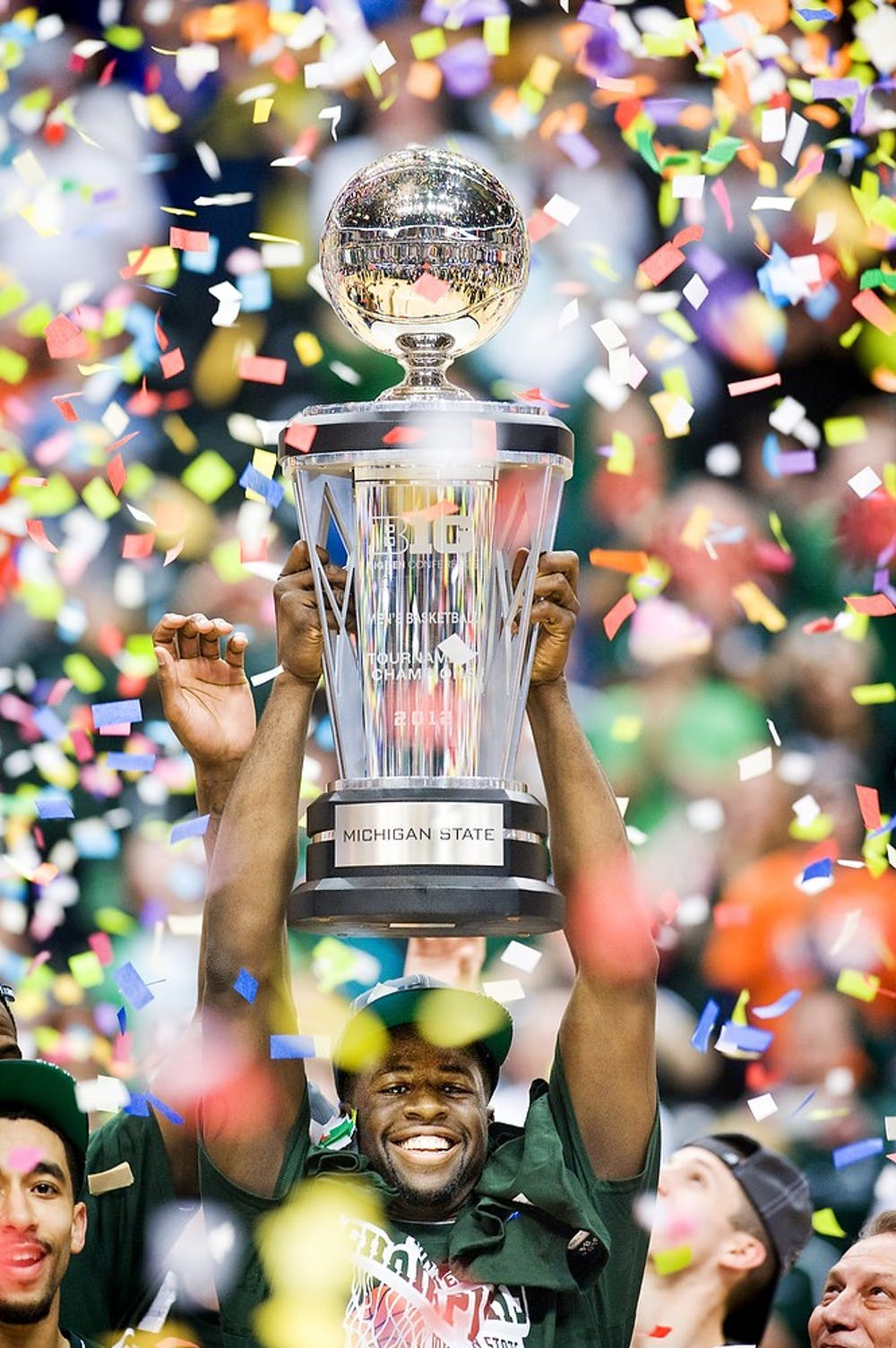 <p>Then-senior forward Draymond Green holds the Big Ten Tournament championship trophy after the game against Ohio State. The Spartans  won their first Big Ten Tournament in 12 years by defeating the Buckeyes, 68-64, at Bankers Life Fieldhouse in Indianapolis on March 11, 2012.</p>