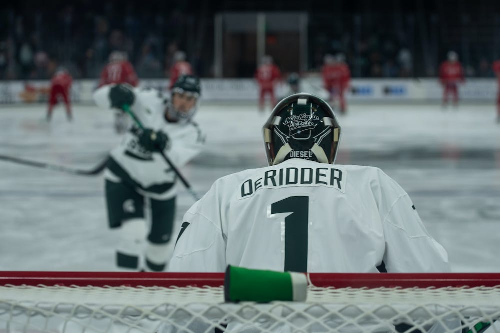 <p>Junior goaltender Drew DeRidder warms up prior to the Spartans' matchup with Ohio State on Jan. 24. DeRidder held the Buckeyes to no goals in the Spartans 2-0 victory. </p>