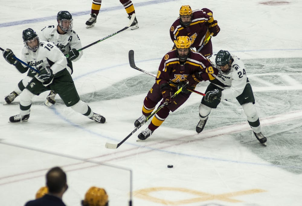 <p>Senior forward Austin Kamer (24) skates towards the puck after a face-off in the second period. The Spartans fell to the Golden Gophers, 3-1, on Dec. 3, 2020.</p>
