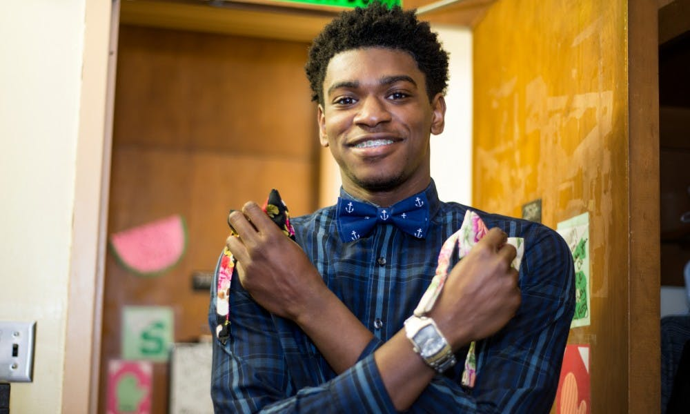 Business freshman William Murphy holds two bowties on March 18, 2016 at East McDonel Hall. Murphy has been running his bowtie business, Reign Bow Ties, for almost a year. Murphy's mother makes all of the bowties by hand with a cotton and linen blend fabric.