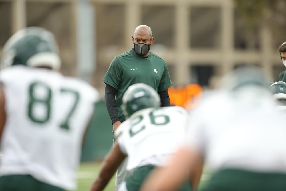 <p>Coach Mel Tucker watches during the Spartans&#x27; opening day of spring ball on March 23, 2021, at the MSU football practice facility. Photo courtesy of MSU Athletic Communications.</p>