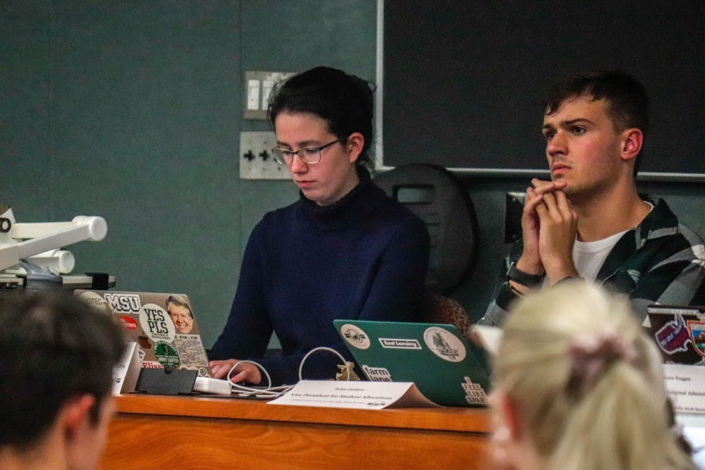 Vice President of Governmental Affairs Maysa Sitar, left, and Vice President for Student Allocations Dylan Catalano, right, listen at the ASMSU meeting on Oct. 3, 2019.