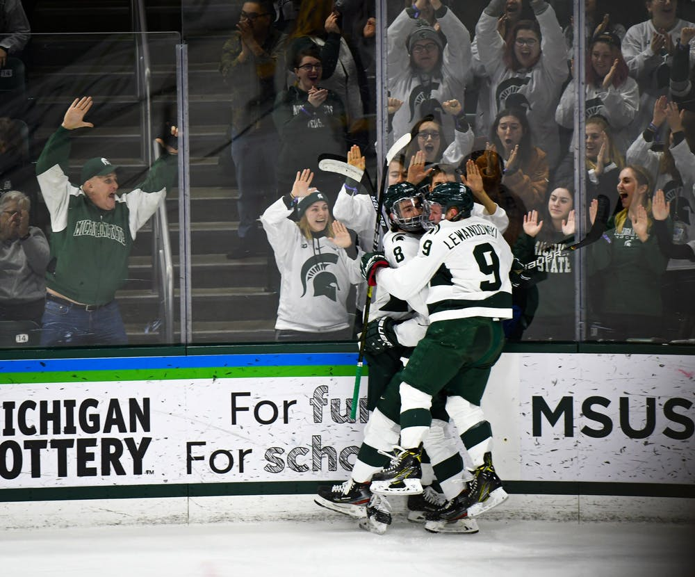<p>MSU players celebrate another goal during the hockey game against Minnesota at the Munn Ice Arena on Jan. 10. The Spartans defeated the Golden Gophers 4-1. </p>