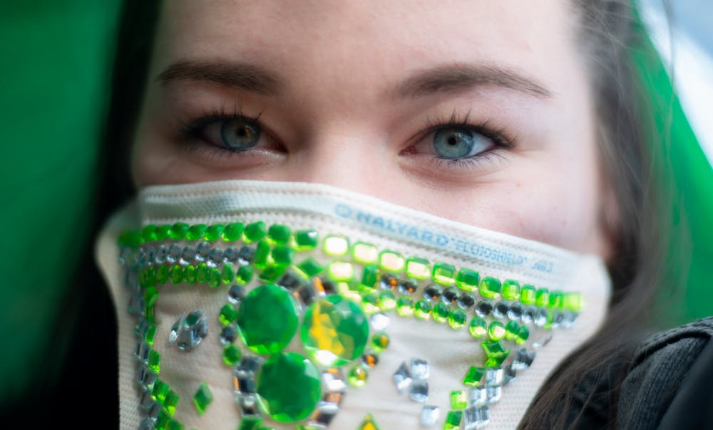 GVSU junior Natalie Cousins poses for a portrait with a bedazzled mask on March 17, 2020.