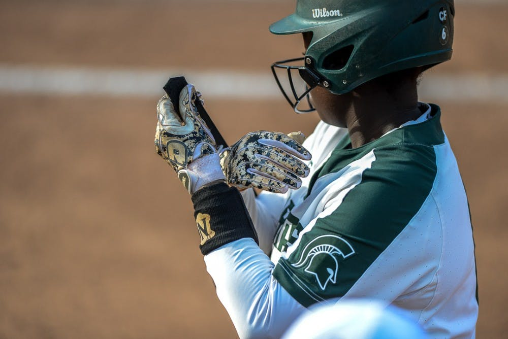 <p>A Spartan softball player adjusts her gloves during the game against Oakland on April,3, 2019 at Secchia Stadium. The Spartans beat the Golden Grizzlies, 11-3.   </p>