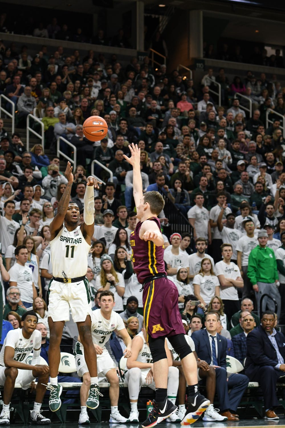 <p>Sophomore forward Aaron Henry (11) takes a shot during the game against Minnesota on Jan. 9, 2020, at the Breslin Center. The Spartans defeated the Golden Gophers, 74-58.</p>
