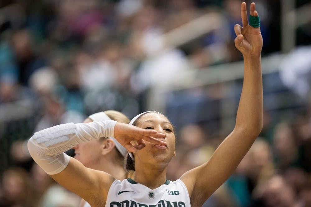 <p>Freshman guard Aerial Powers celebrates a three-pointer by freshman guard Tori Jankoska during the game against Colgate on Dec. 29, 2013, at Breslin Center. The Spartans won, 96-46. Julia Nagy/The State News</p>