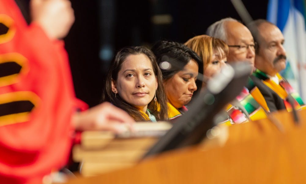 (Name) looks on as the ceremony starts. The Hispanic/Latino Commission of Michigan held its Statewide College Graduation Ceremony at Lansing Community College's Dart Auditorium on April 5, 2019.