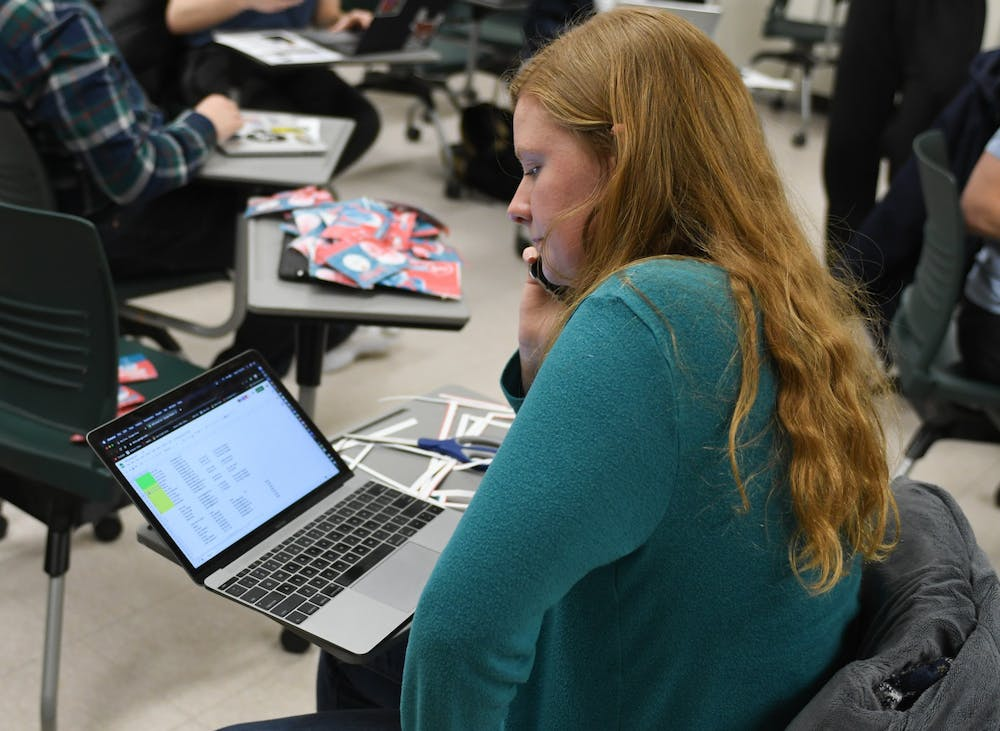 <p>Global and international studies sophomore Aurora Seelye calls potential new organization participants during the Spartans for Sanders meeting at Wells Hall on Feb.5, 2020. </p>