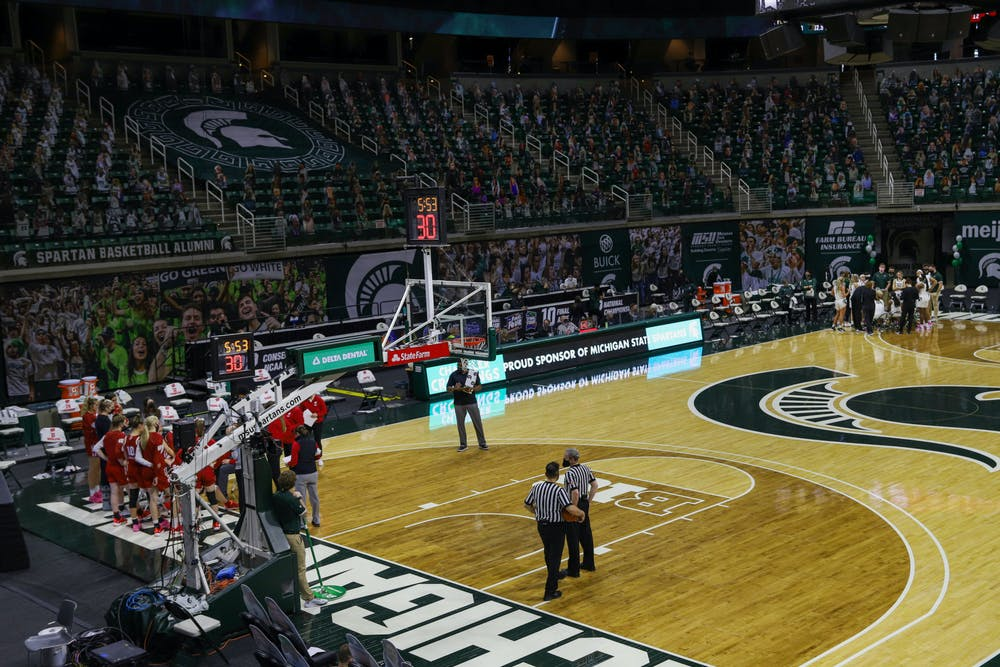 A time out during the game against Wisconsin on Saturday, Mar. 6, 2021 in East Lansing.