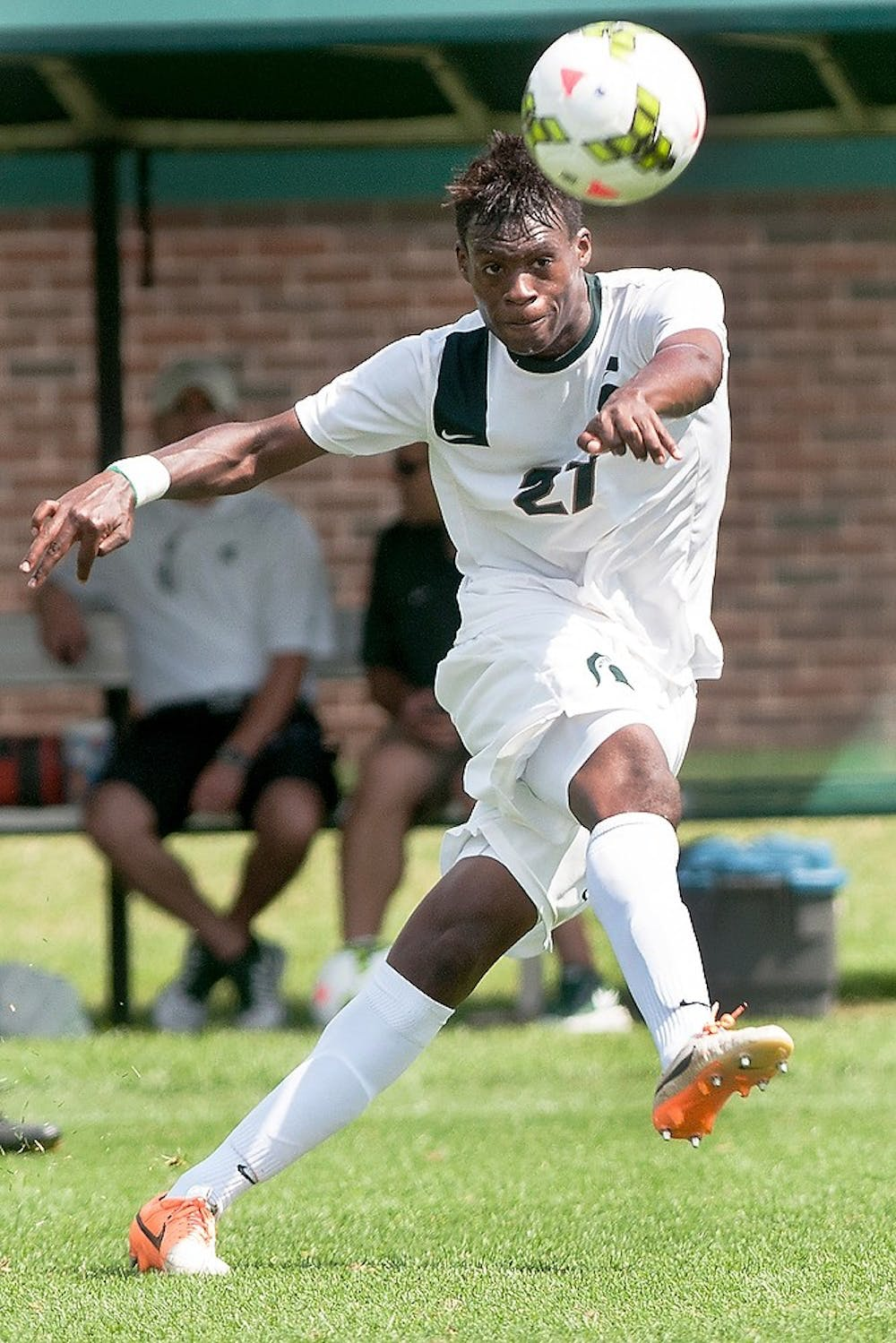 <p>Senior midfielder Fatai Alashe passes the ball during a game against Florida International University Aug. 31, 2014, at DeMartin Soccer Stadium at Old College Field. The Spartans defeated the Panthers, 3-0. Raymond Williams/The State News</p>
