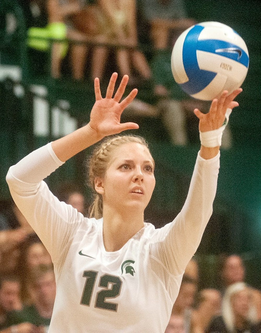 <p>Freshman setter Rachel Minarick serves the ball during a volleyball game against the University of North Carolina on Sept. 5, 2014, at Jenison Fieldhouse. The Rams defeated the Spartans, 3-0. Jessalyn Tamez/The State News. </p>