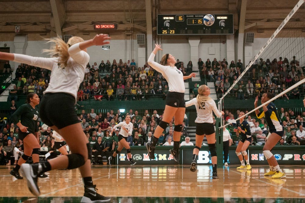 <p>Sophomore middle blocker Megan Tompkins gets ready to spike the ball at the volleyball game against Michigan on Sept. 30, 2015 at Jenison Field House. The Spartans defeated the Wolverines, 3-0. </p>