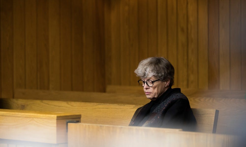 Former Michigan State President Lou Anna K. Simon waits for a preliminary hearing at Eaton County District Court to begin April 16, 2019. Simon is charged with four counts of lying to a peace officer, including two felonies.