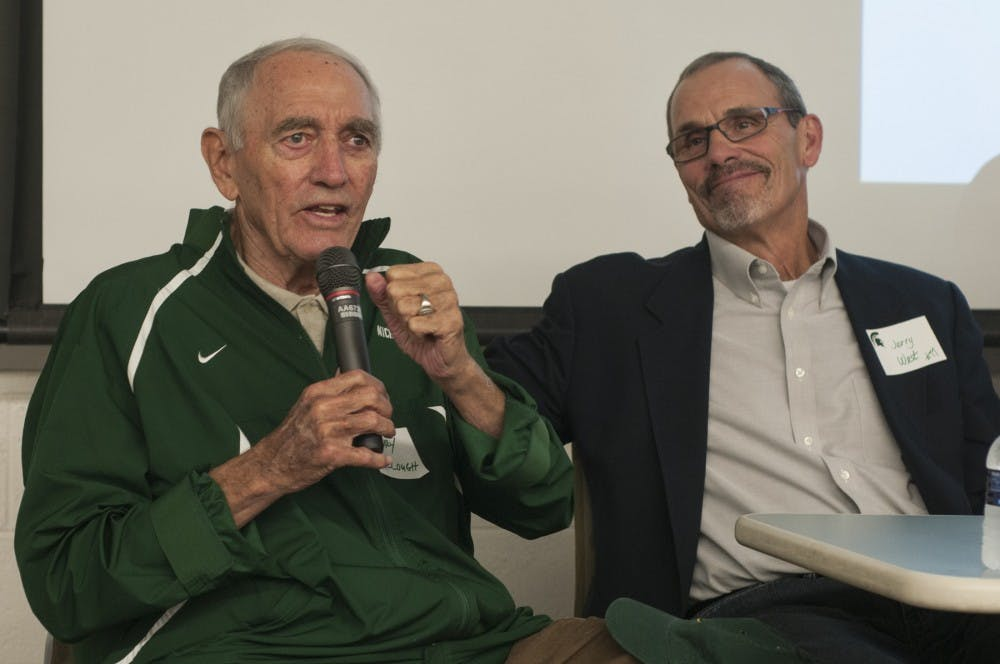 From left, former MSU coach Henry Bullough speaks into a microphone while former MSU player Jerry West listens on Oct. 12, 2016 in Conrad Hall. Bullough coached and West played on the MSU football teamd during their 1966 game against Notre Dame.