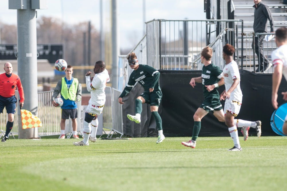 Sophomore forward Ryan Sierakowski (11) sends in a cross during the Big Ten men's soccer semifinal against Maryland on Nov. 11, 2016 at Grand Park in Westfield, Ind. The Spartans were defeated by the Terrapins, 2-1.