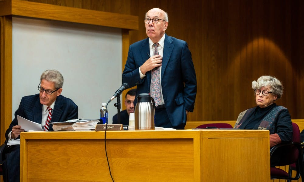 Defense attorney Terry Dillon (center) objects to a line of questioning during the seventh day of former MSU President Lou Anna K. Simon's (right) preliminary examination at the Eaton County Courthouse on July 23, 2019.