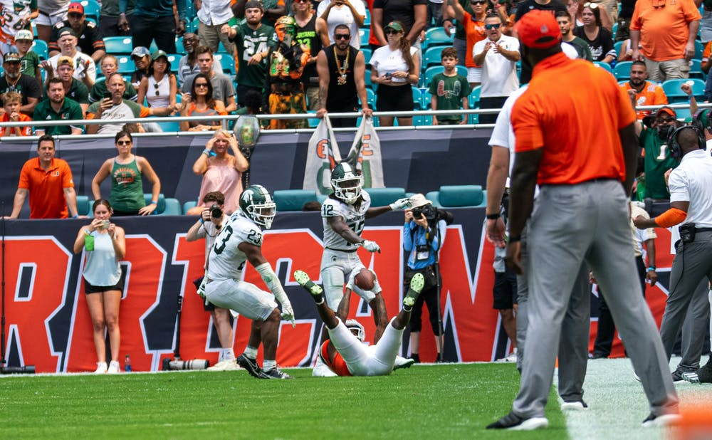 <p>Junior centerback Chester Kimbrough (12) and sophomore safety Darius Snow (23) try to show the ball was dropped in the third quarter. The Spartans beat the Hurricanes 38-17 at Hard Rock Stadium on Sept. 18, 2021.</p>