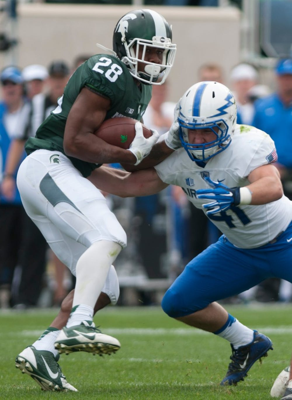 <p>Air Force linebacker Patrick Healy tackles redshirt freshman running back Madre London in the first half during the game against Air Force on Sept. 19, 2015 at Spartan Stadium. The Spartans defeated the Falcons, 35-21. Kennedy Thatch/The State News</p>